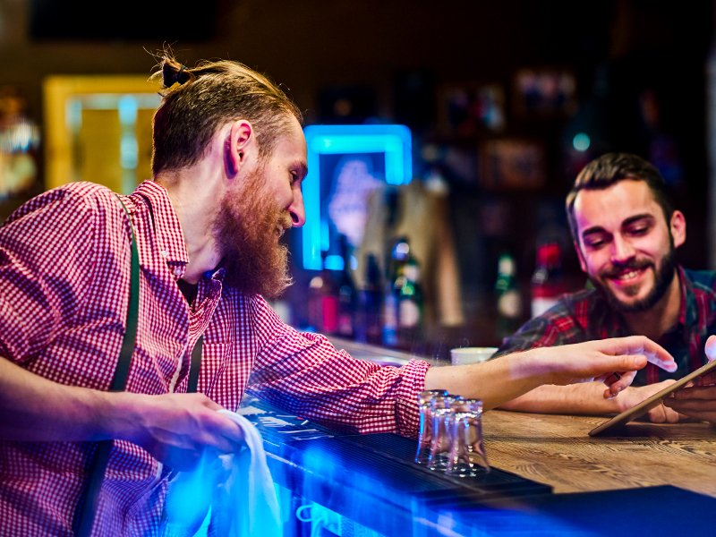 Sideshow Pete Bartender serving customer upselling drinks making money