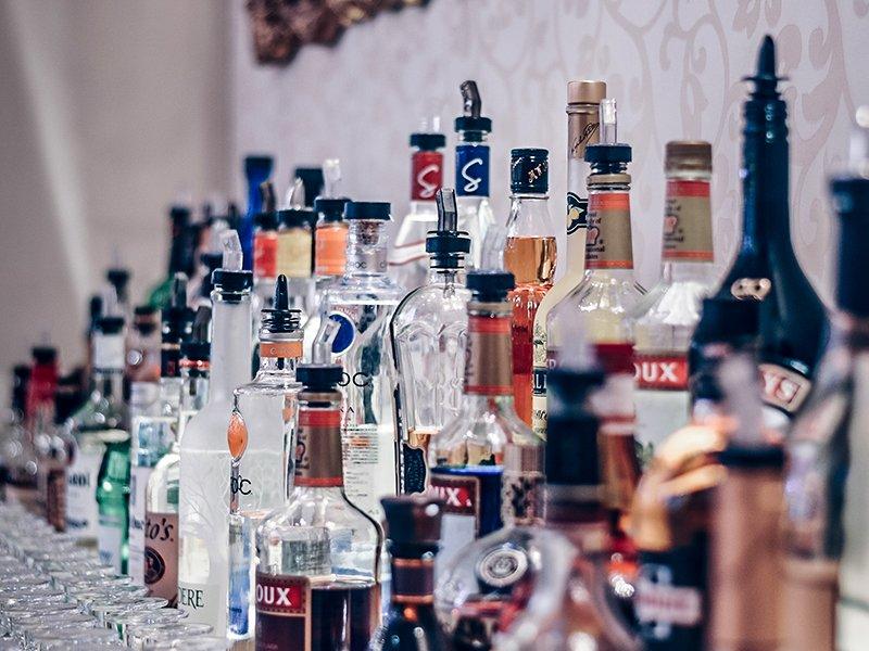 Sideshow Pete liquor bottles arranged behind a bar