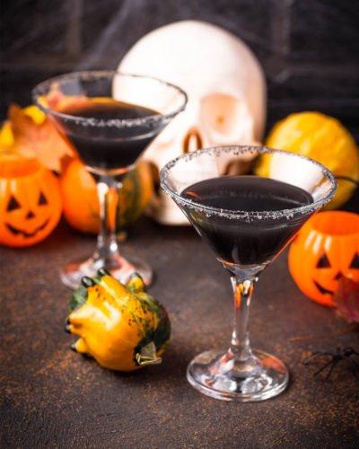 dark of night halloween cocktail black vodka blue curacao grenadine